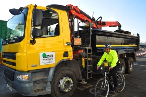 Cllr Bassam Mahfouz cycling next to lorry fitted with sensors